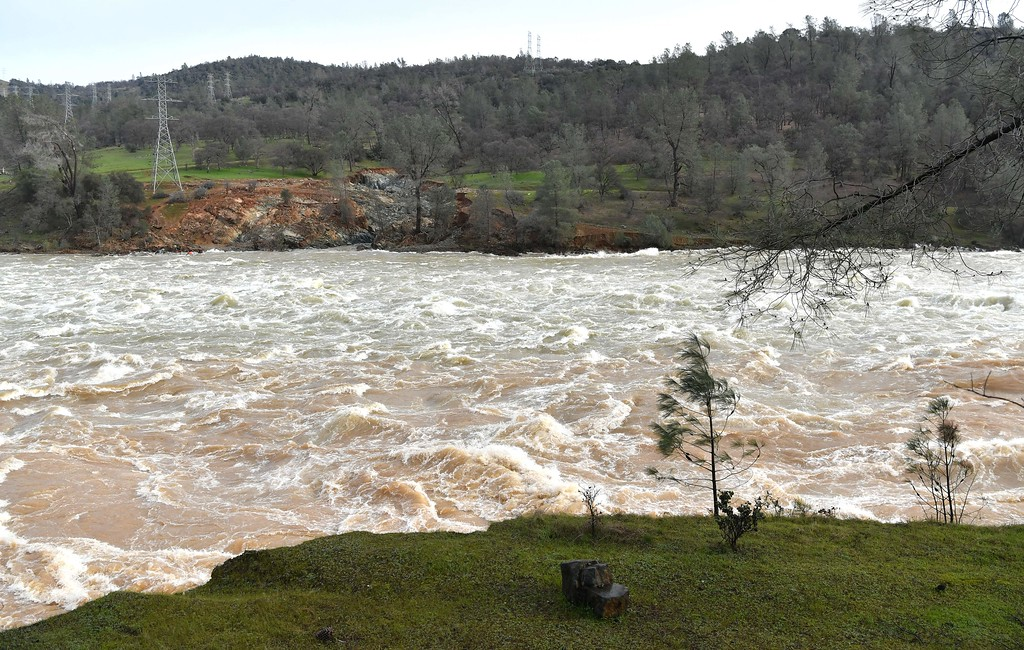 . Water rushes down a spillway as an emergency measure at the Oroville Dam in Oroville, California on February 13, 2017. Almost 200,000 people were under evacuation orders in northern California Monday after a threat of catastrophic failure at the United States\' tallest dam. Officials said the threat had subsided for the moment as water levels at the Oroville Dam, 75 miles (120 kilometers) north of San Francisco, have eased. But people were still being told to stay out of the area. (JOSH EDELSON/AFP/Getty Images)