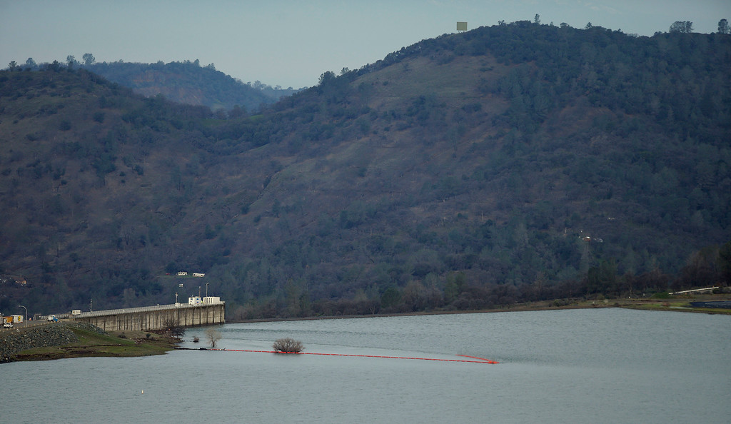 . This photo shows the emergency spillway at the Oroville Dam shortly early Monday, Feb. 13, 2017, in Oroville, Calif. Water levels at Lake Oroville are continuing to drop Monday and stopping water from spilling over the spillway. Evacuations for people living below the lake were ordered Sunday after authorities warned the emergency spillway of the Oroville Dam could fail at any time unleashing uncontrolled flood waters on towns below. (AP Photo/Rich Pedroncelli)