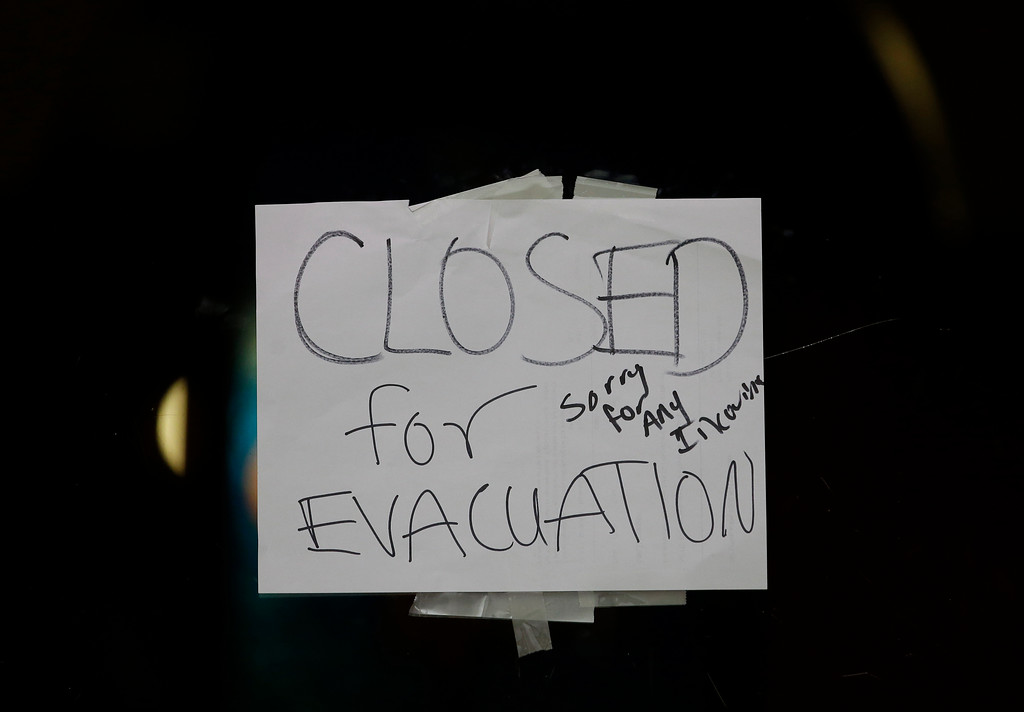 . A closed sign is displayed on the door of Papaciito\'s restaurant due to an evacuation order Sunday, Feb. 12, 2017, in Marysville, Calif. Thousands of Northern California residents remain under evacuation orders after authorities warned an emergency spillway in the country\'s tallest Oroville Dam was in danger of failing Sunday and unleashing uncontrolled flood waters on towns below. (AP Photo/Rich Pedroncelli)