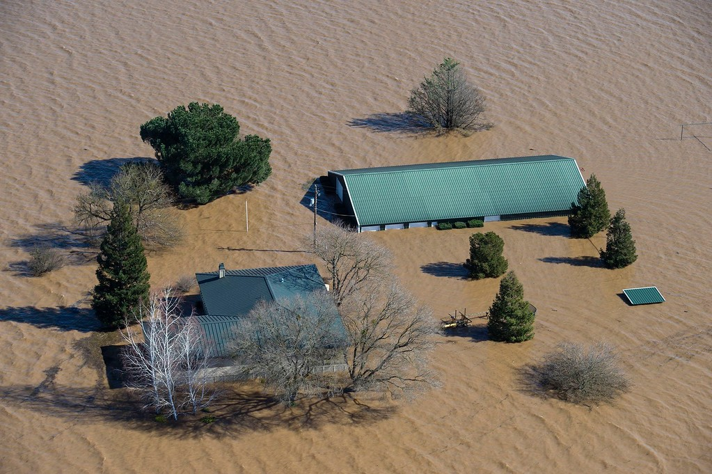 . Water from the Cosumnes and Mokelumne rivers floods a house and barn north of Twin Cities Road east of Interstate 5, Saturday, Feb. 11, 2017 in Elk Grove, Calif. Water started flowing over an emergency spillway at the nation\'s tallest dam, on Lake Oroville, for the first time Saturday after erosion damaged the Northern California dam\'s main spillway. (Randy Pench/The Sacramento Bee via AP)