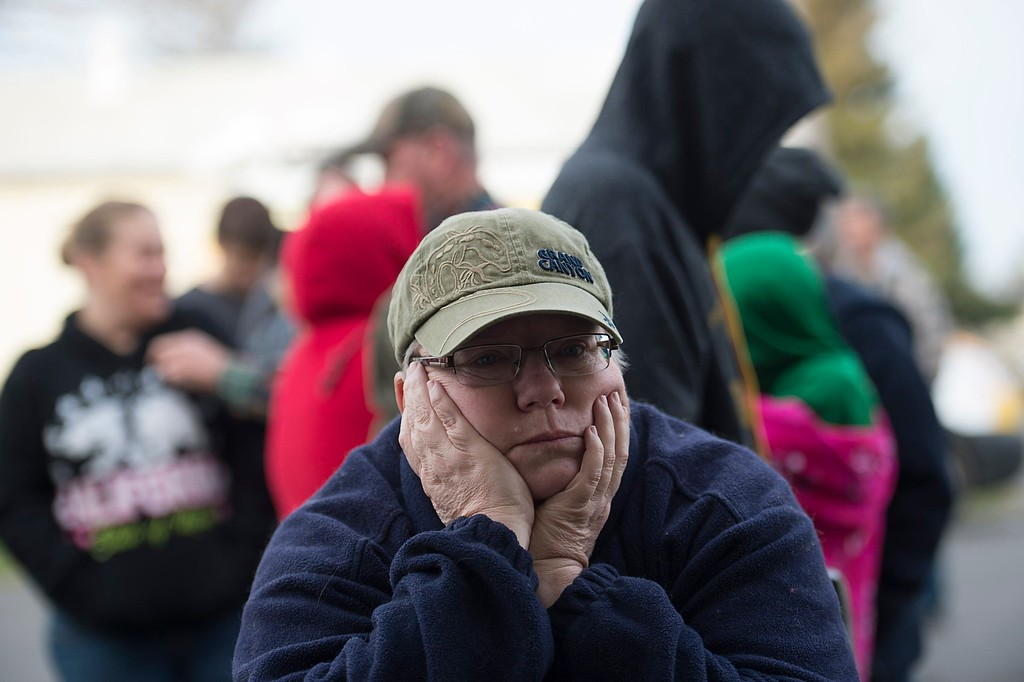 . Paula Gillock, 53, waits in line for breakfast at the Silver Dollar Fairground on Monday, Feb. 13, 2017, in Chico, Calif. She left her home in Gridley and slept in her car with her cat Mimi after residents were evacuated from the possible failure of the emergency spillway at the Oroville Dam. Sunday afternoon\'s evacuation order came after engineers spotted a hole on the concrete lip of the secondary spillway for the 770-foot-tall Oroville Dam and told authorities that it could fail within the hour. The water level dropped Monday, reducing the risk of a catastrophic spillway collapse and easing fears that prompted the evacuation of nearly 200,000 people downstream.(Paul Kitagaki Jr./The Sacramento Bee via AP)