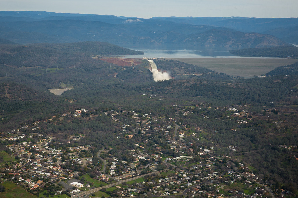 . OROVILLE, CA - FEBRUARY 13: Oroville lake, the emergency spillway, the damaged main spillway, and the earthen Oroville Dam are seen behind the town of Oroville from the air on February 13, 2017 in Oroville, California. Almost 200,000 people were ordered to evacuate the northern California town after a hole in the emergency spillway in the Oroville Dam threatened to flood the surrounding area. (Photo by Elijah Nouvelage/Getty Images)