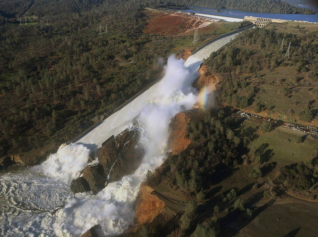 . This Saturday, Feb. 11, 2017, aerial photo released by the California Department of Water Resources shows the damaged spillway with eroded hillside in Oroville, Calif.   Thousands of residents of Marysville and other Northern California communities were told to leave their homes Sunday evening as an emergency spillway of the Oroville Dam could fail at any time unleashing flood waters from Lake Oroville, according to officials from the California Department of Water Resources. (William Croyle/California Department of Water Resources via AP)