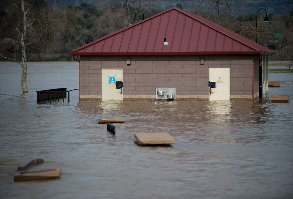 . A bathroom building is seen partially submerged in flowing water at Riverbend Park in Oroville, California on February 13, 2017. Almost 200,000 people were under evacuation orders in northern California Monday after a threat of catastrophic failure at the United States\' tallest dam. Officials said the threat had subsided for the moment as water levels at the Oroville Dam, 75 miles (120 kilometers) north of San Francisco, have eased. But people were still being told to stay out of the area. (JOSH EDELSON/AFP/Getty Images)