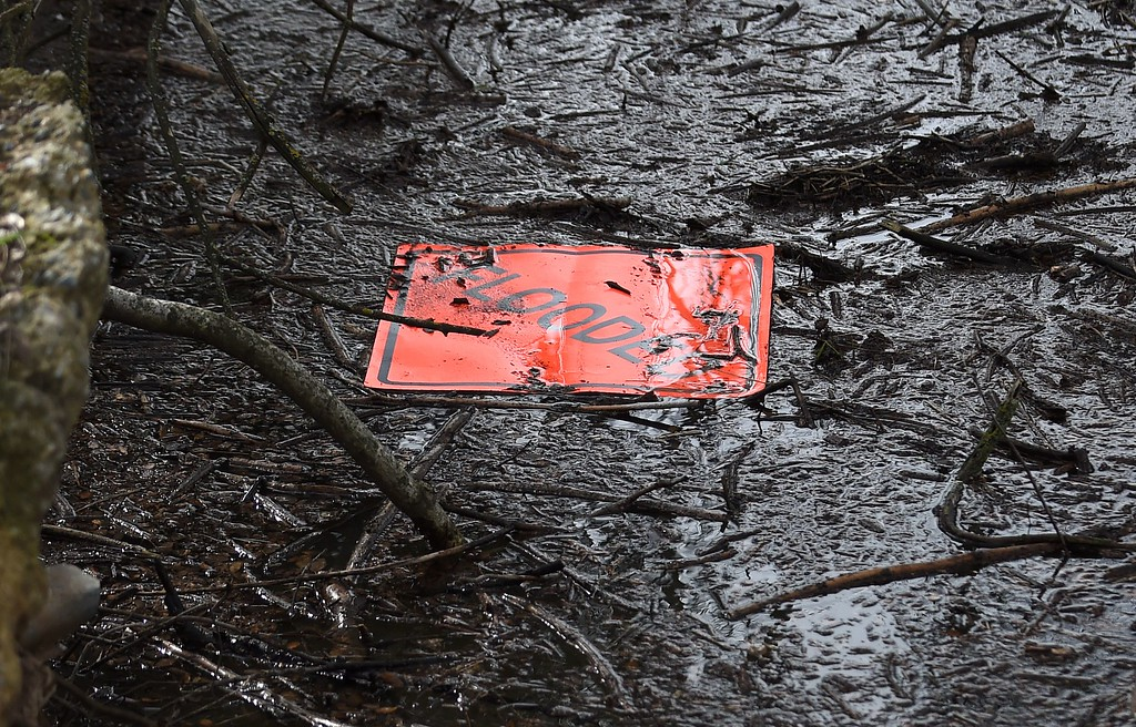 . A sign is seen floating in a marsh at the flooded Riverbend Park as the Oroville Dam releases water down the spillway in Oroville, California on February 13, 2017. Almost 200,000 people were under evacuation orders in northern California Monday after a threat of catastrophic failure at the United States\' tallest dam. Officials said the threat had subsided for the moment as water levels at the Oroville Dam, 75 miles (120 kilometers) north of San Francisco, have eased. But people were still being told to stay out of the area. (JOSH EDELSON/AFP/Getty Images)