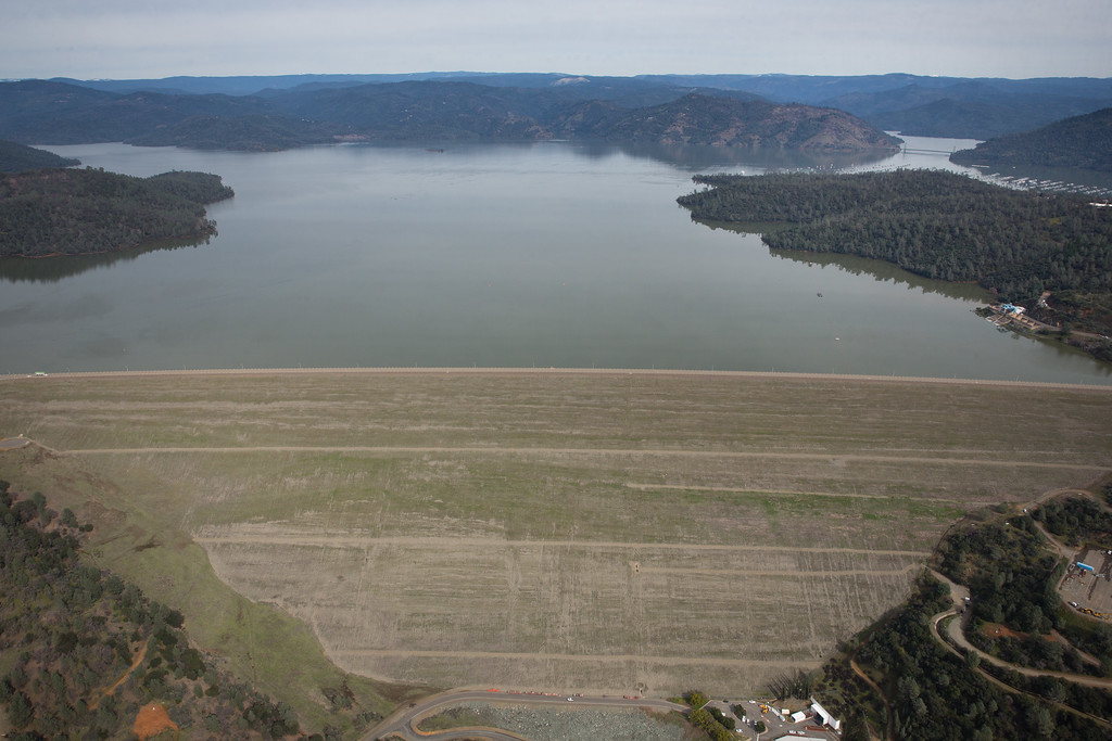 . OROVILLE, CA - FEBRUARY 13: Oroville Lake  and its spillways are seen from the air on February 13, 2017 in Oroville, California. Almost 200,000 people were ordered to evacuate the northern California town after a hole in an emergency spillway in the Oroville Dam threatened to flood the surrounding area.  (Photo by Elijah Nouvelage/Getty Images)