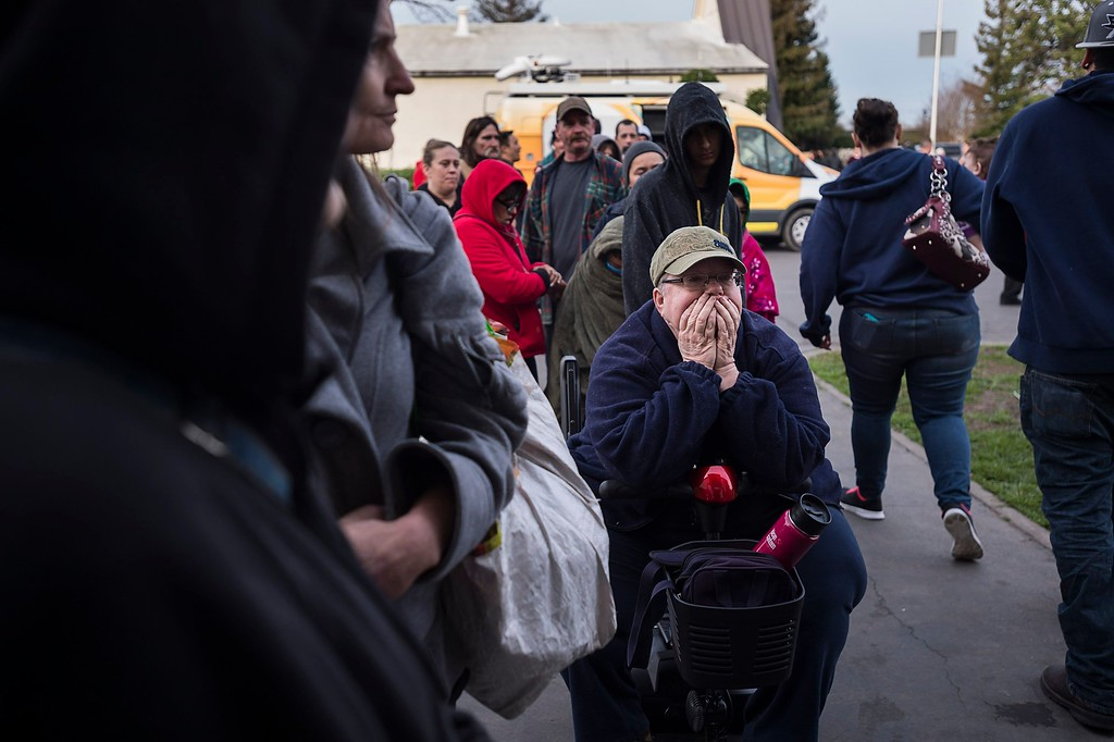 . Paula Gillock, 53, waits in line for breakfast at the Silver Dollar Fairgrounds on Monday, Feb. 13, 2017, in Chico, Calif. She left her home in Gridley and slept in her car with her cat Mimi after residents were evacuated from the area due to fears of a possible failure of the emergency spillway at the Oroville Dam.(Paul Kitagaki Jr./The Sacramento Bee via AP)