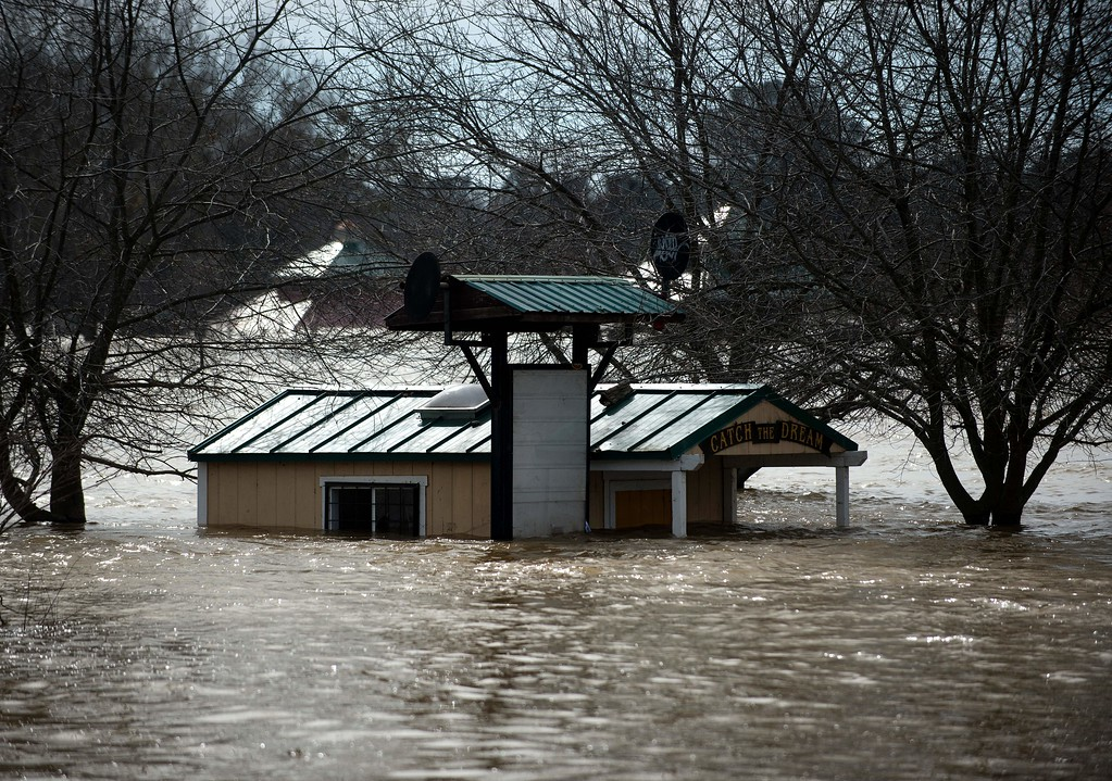 . A building is seen submerged in flowing water at Riverbend Park as the Oroville Dam releases water down the spillway as an emergency measure in Oroville, California on February 13, 2017. Almost 200,000 people were under evacuation orders in northern California Monday after a threat of catastrophic failure at the United States\' tallest dam. Officials said the threat had subsided for the moment as water levels at the Oroville Dam, 75 miles (120 kilometers) north of San Francisco, have eased. But people were still being told to stay out of the area. (JOSH EDELSON/AFP/Getty Images)