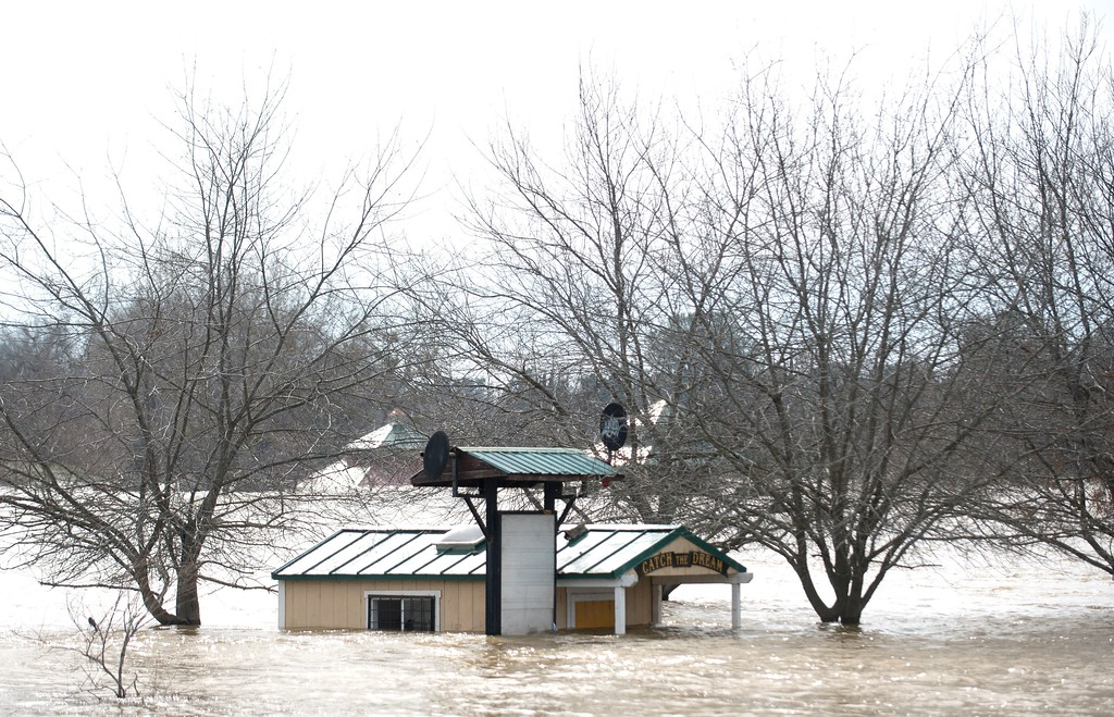 . A building is seen submerged in flowing water at Riverbend Park as the Oroville Dam releases water down the spillway in an emergency measure in Oroville, California on February 13, 2017.  Almost 200,000 people were under evacuation orders in northern California Monday after a threat of catastrophic failure at the United States\' tallest dam. Officials said the threat had subsided for the moment as water levels at the Oroville Dam, 75 miles (120 kilometers) north of San Francisco, have eased. But people were still being told to stay out of the area. (JOSH EDELSON/AFP/Getty Images)
