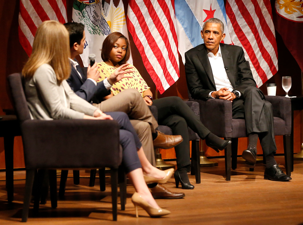 . Former President Barack Obama listens to Ramuel Figueroa, second from left, as Kelsey McClear, left, and Tiffany Brown participate in a conversation on civic engagement and community organizing, Monday, April 24, 2017, at the University of Chicago in Chicago. It\'s the former president\'s first public event of his post-presidential life in the place where he started his political career. (AP Photo/Charles Rex Arbogast)
