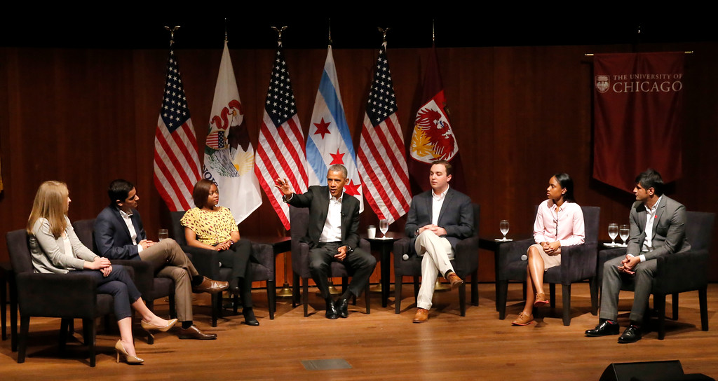 . Former President Barack Obama, center, hosts a conversation on civic engagement and community organizing, Monday, April 24, 2017, at the University of Chicago in Chicago. From left are, Kelsey McClear, Loyola University; Ramuel Figueroa, Roosevelt University; Tiffany Brown a pharmacist; Obama, Max Freedman, University of Chicago; Ayanna Watkins, Kenwood High School; and Harish Patel, New America. (AP Photo/Charles Rex Arbogast)