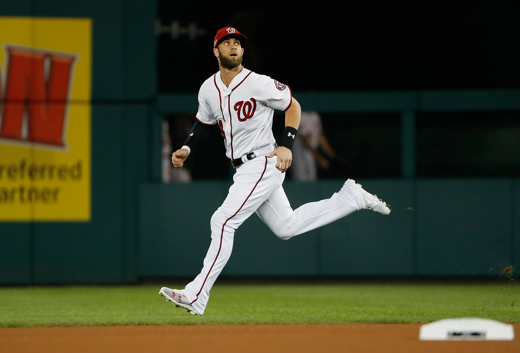 . Washington Nationals right fielder Bryce Harper warms up before Game 5 of baseball\'s National League Division Series, against the Los Angeles Dodgers at Nationals Park, Thursday, Oct. 13, 2016, in Washington. (AP Photo/Pablo Martinez Monsivais)