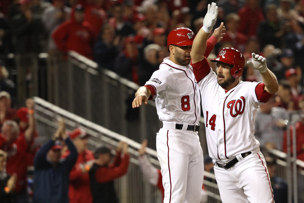 . WASHINGTON, DC - OCTOBER 13: Chris Heisey #14 of the Washington Nationals celebrates with teammate Danny Espinosa #8 after hitting a two run home run in the seventh inning against the Los Angeles Dodgers during game five of the National League Division Series at Nationals Park on October 13, 2016 in Washington, DC. (Photo by Patrick Smith/Getty Images)