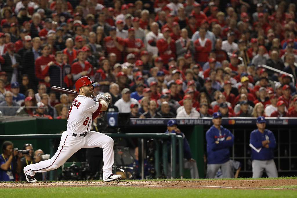 . WASHINGTON, DC - OCTOBER 13: Danny Espinosa #8 of the Washington Nationals hits an RBI single against the Los Angeles Dodgers in the second inning during game five of the National League Division Series at Nationals Park on October 13, 2016 in Washington, DC. (Photo by Patrick Smith/Getty Images)