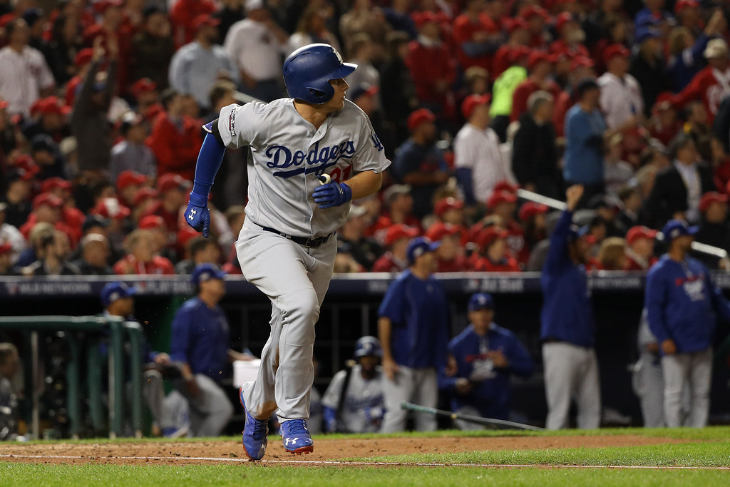 . WASHINGTON, DC - OCTOBER 13: Joc Pederson #31 of the Los Angeles Dodgers hits a solo home run in the seventh inning against the Washington Nationals during game five of the National League Division Series at Nationals Park on October 13, 2016 in Washington, DC. (Photo by Patrick Smith/Getty Images)