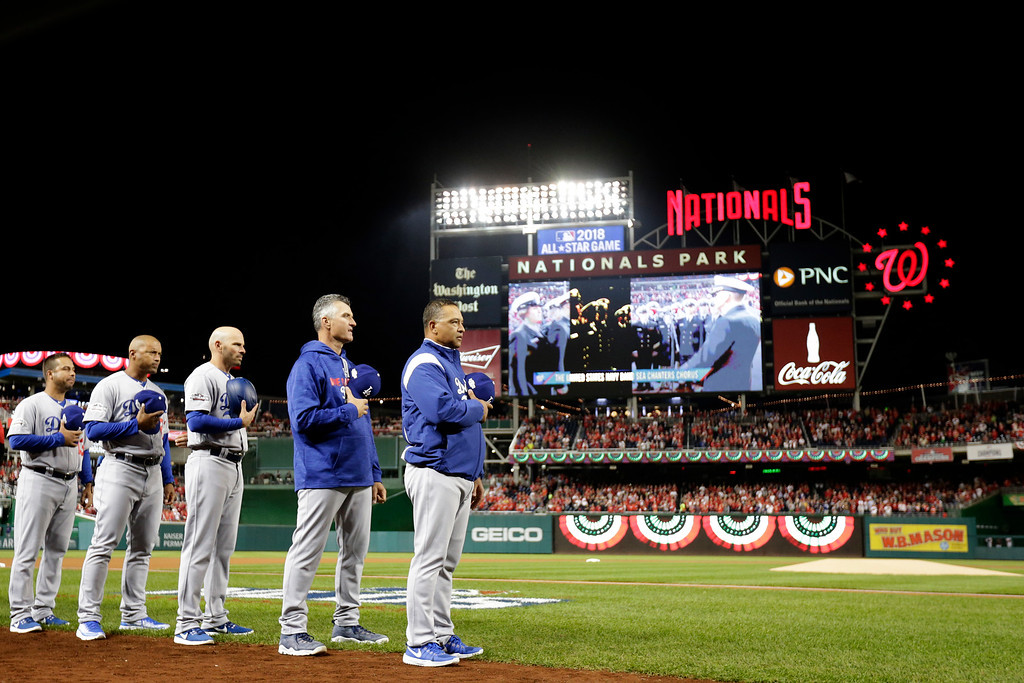 . WASHINGTON, DC - OCTOBER 13: The Los Angeles Dodgers stand during the national anthem prior to game five of the National League Division Series against the Washington Nationals at Nationals Park on October 13, 2016 in Washington, DC. (Photo by Rob Carr/Getty Images)