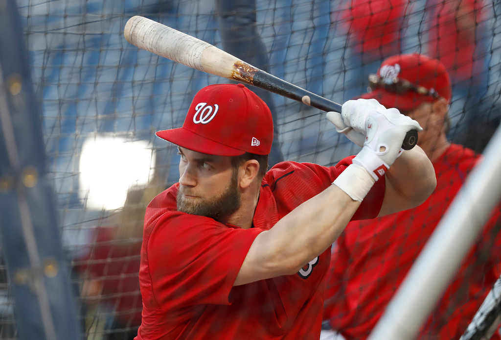 . Washington Nationals right fielder Bryce Harper waits to swing during batting practice before Game 5 of baseball\'s National League Division Series against the Los Angeles Dodgers at Nationals Park, Thursday, Oct. 13, 2016, in Washington. (AP Photo/Alex Brandon)