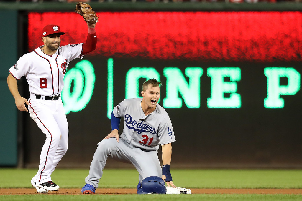 . WASHINGTON, DC - OCTOBER 13: Joc Pederson #31 of the Los Angeles Dodgers celebrates after advancing to second base against Danny Espinosa #8 of the Washington Nationals in the fifth inning during game five of the National League Division Series at Nationals Park on October 13, 2016 in Washington, DC. (Photo by Rob Carr/Getty Images)