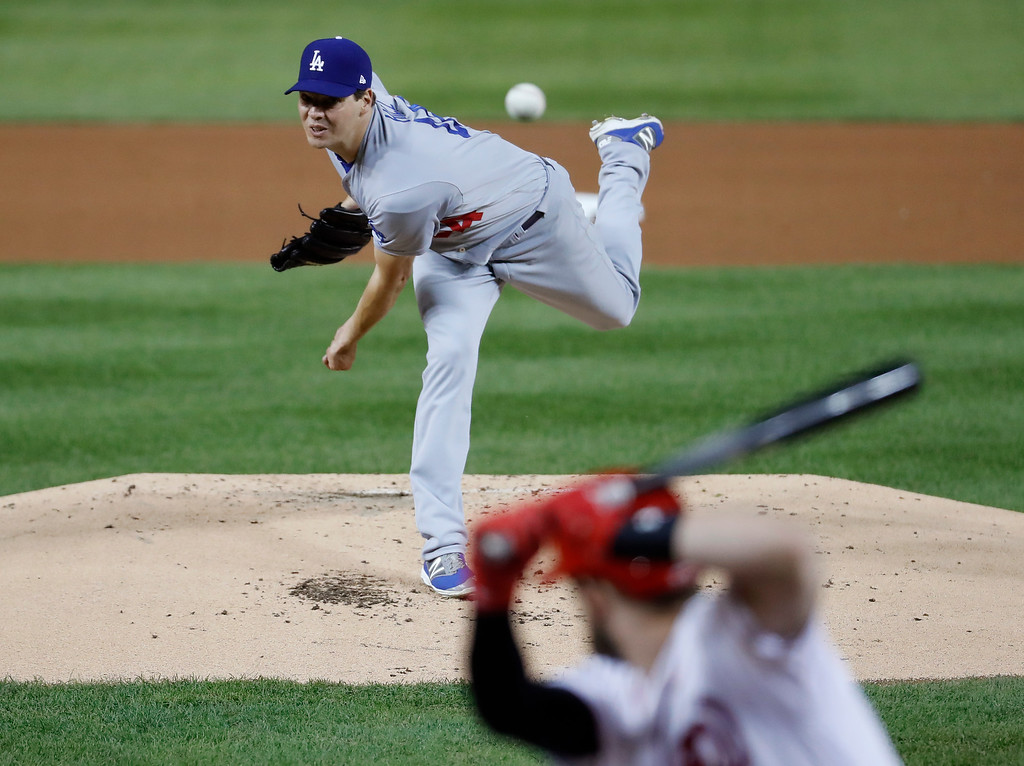 . Los Angeles Dodgers starting pitcher Rich Hill throws during the first inning of Game 5 against the Washington Nationals in baseball\'s National League Division Series, at Nationals Park on Thursday, Oct. 13, 2016, in Washington. (AP Photo/Alex Brandon, Pool)