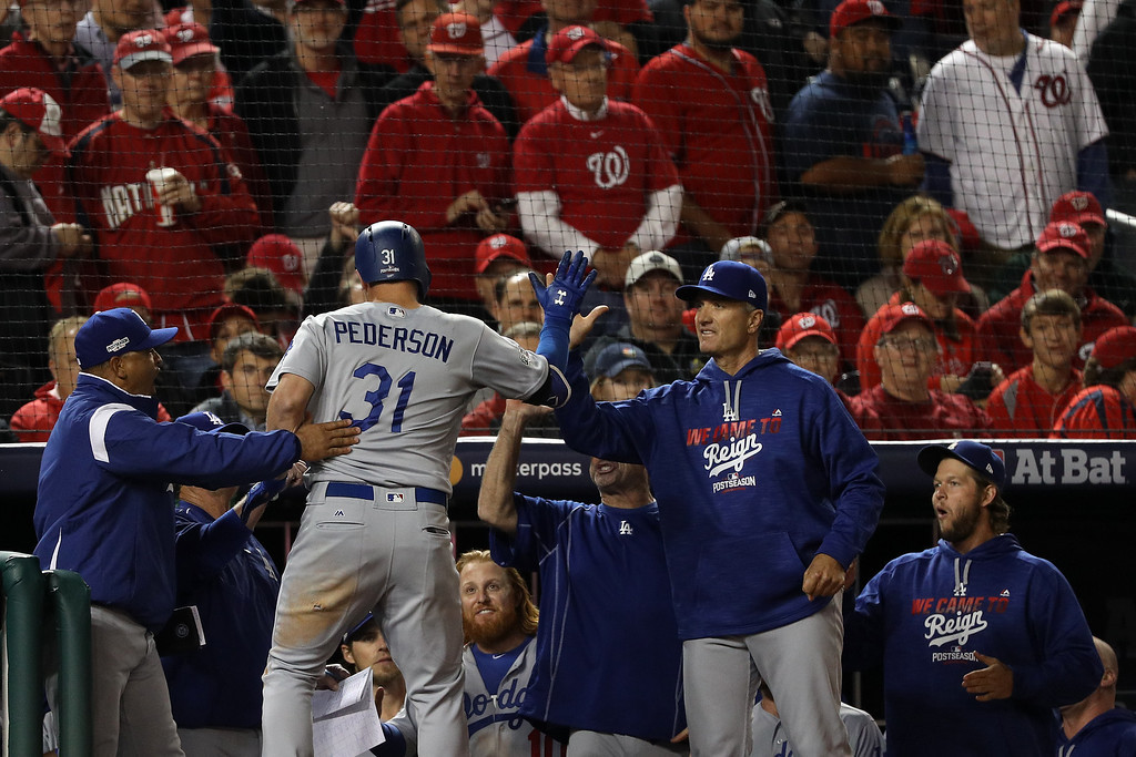 . WASHINGTON, DC - OCTOBER 13: Joc Pederson #31 of the Los Angeles Dodgers celebrates with teammates after hitting a solo home run in the seventh inning against the Washington Nationals during game five of the National League Division Series at Nationals Park on October 13, 2016 in Washington, DC. (Photo by Patrick Smith/Getty Images)