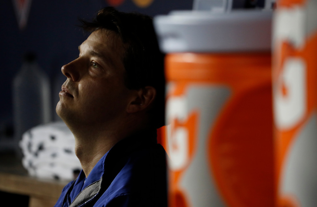 . Los Angeles Dodgers starting pitcher Rich Hill sits in the dugout before Game 5 of baseball\'s National League Division Series against the Washington Nationals at Nationals Park, Thursday, Oct. 13, 2016, in Washington. Hill was replaced by reliever Joe Blanton during the third inning. (AP Photo/Pablo Martinez Monsivais)