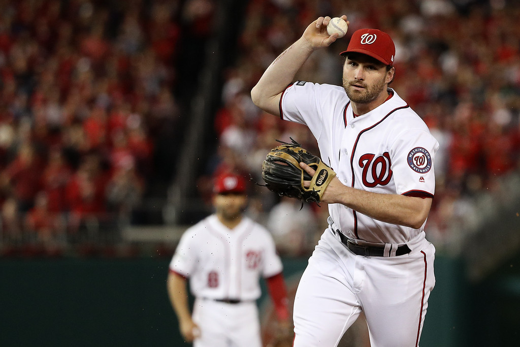 . WASHINGTON, DC - OCTOBER 13: Daniel Murphy #20 of the Washington Nationals makes a throw to first base for the second out of the second inning against the Los Angeles Dodgers during game five of the National League Division Series at Nationals Park on October 13, 2016 in Washington, DC. (Photo by Patrick Smith/Getty Images)
