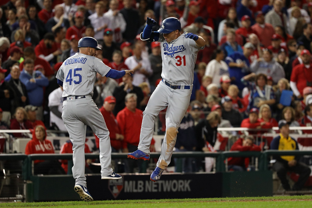 . WASHINGTON, DC - OCTOBER 13: Joc Pederson #31 of the Los Angeles Dodgers celebrates with third base coach Chris Woodward #45 after hitting a solo home run in the seventh inning against the Washington Nationals during game five of the National League Division Series at Nationals Park on October 13, 2016 in Washington, DC. (Photo by Patrick Smith/Getty Images)