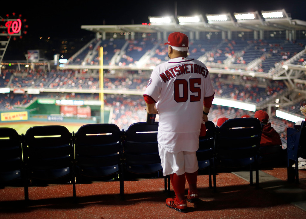 ". Wearing a jersey ""Natswetrust\"" jersey Phil Gastilo of Fort Washington, Md., looks out over Nationals Park before Game 5 of baseball\'s National League Division Series between the Washington Nationals and the Los Angeles Dodgers, Thursday, Oct. 13, 2016, in Washington. (AP Photo/Pablo Martinez Monsivais)"