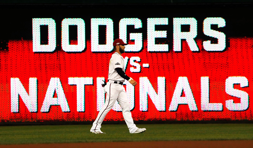 . Washington Nationals right fielder Bryce Harper walks in the outfield before Game 5 of baseball\'s National League Division Series, against the Los Angeles Dodgers at Nationals Park, Thursday, Oct. 13, 2016, in Washington. (AP Photo/Pablo Martinez Monsivais)