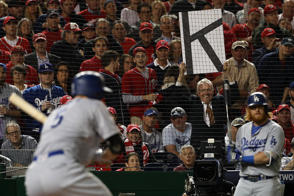 . WASHINGTON, DC - OCTOBER 13: A fan holds a sign during game five of the National League Division Series between the Los Angeles Dodgers and the Washington Nationals at Nationals Park on October 13, 2016 in Washington, DC. (Photo by Patrick Smith/Getty Images)