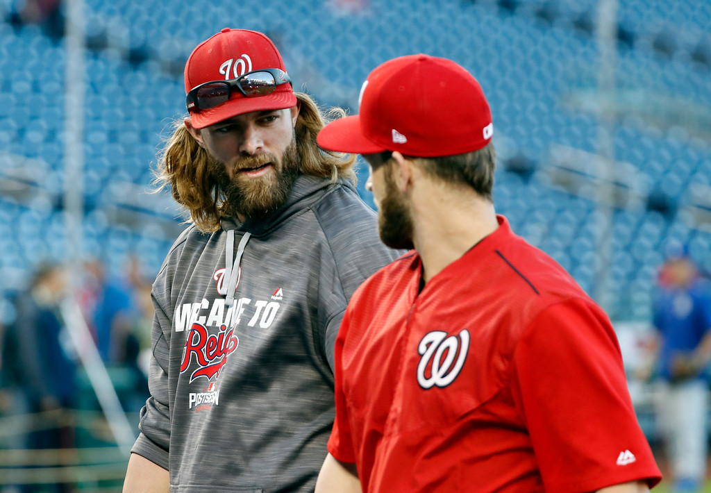 . Washington Nationals left fielder Jayson Werth, left, and right fielder Bryce Harper talk during batting practice before Game 5 of baseball\'s National League Division Series against the Los Angeles Dodgers at Nationals Park, Thursday, Oct. 13, 2016, in Washington. (AP Photo/Alex Brandon)