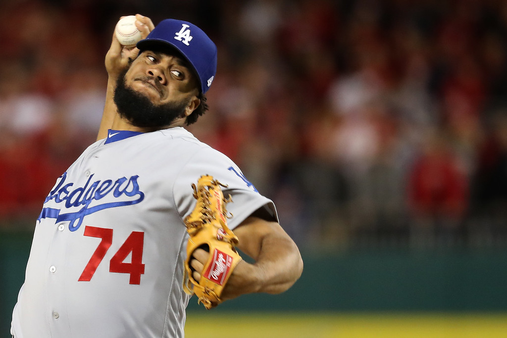 . WASHINGTON, DC - OCTOBER 13: Kenley Jansen #74 of the Los Angeles Dodgers works against the Washington Nationals in the seventh inning during game five of the National League Division Series at Nationals Park on October 13, 2016 in Washington, DC. (Photo by Rob Carr/Getty Images)