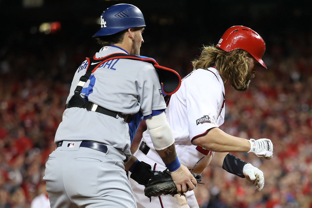 . WASHINGTON, DC - OCTOBER 13: Jayson Werth #28 of the Washington Nationals is tagged out for the third out of the sixth inning by Yasmani Grandal #9 of the Los Angeles Dodgers during game five of the National League Division Series at Nationals Park on October 13, 2016 in Washington, DC. (Photo by Rob Carr/Getty Images)