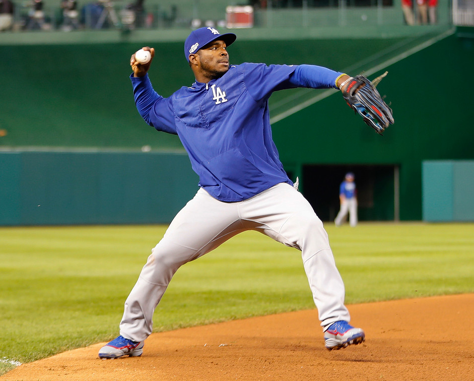 . Los Angeles Dodgers\' Yasiel Puig throws before Game 5 of baseball\'s National League Division Series against the Washington Nationals at Nationals Park, Thursday, Oct. 13, 2016, in Washington. (AP Photo/Pablo Martinez Monsivais)