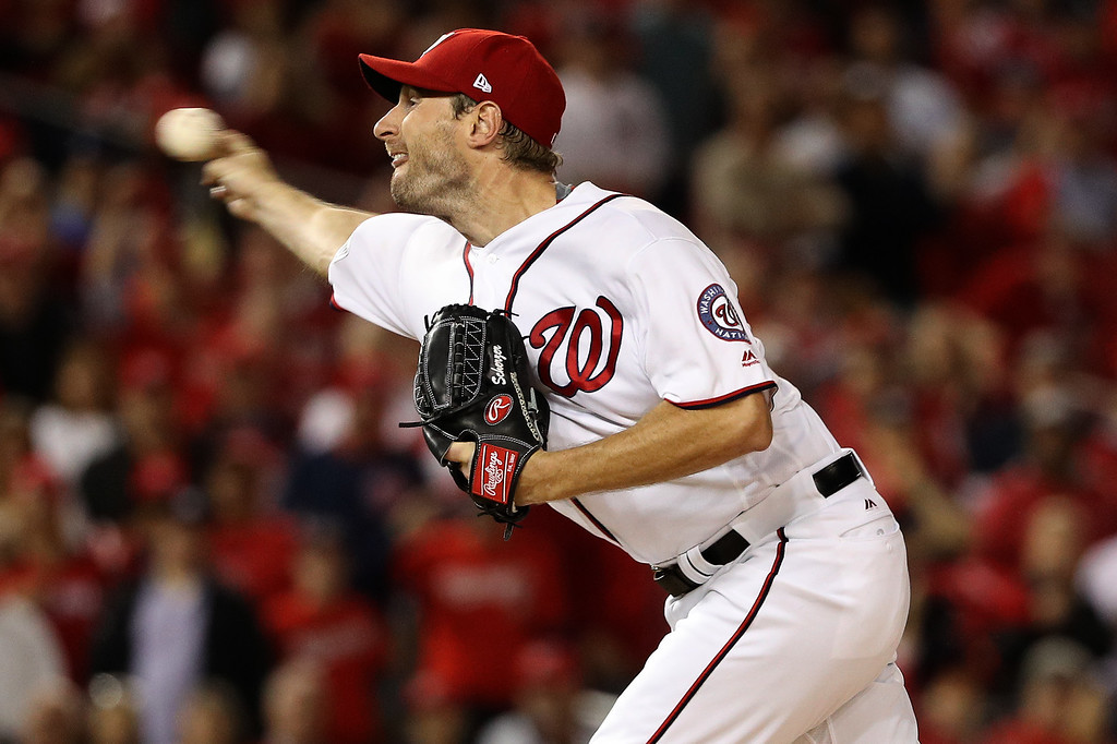 . WASHINGTON, DC - OCTOBER 13: Max Scherzer #31 of the Washington Nationals works against the Los Angeles Dodgers in the first inning during game five of the National League Division Series at Nationals Park on October 13, 2016 in Washington, DC. (Photo by Patrick Smith/Getty Images)
