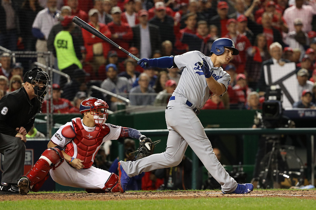 . WASHINGTON, DC - OCTOBER 13: Joc Pederson #31 of the Los Angeles Dodgers hits a single in the fifth inning against the Washington Nationals during game five of the National League Division Series at Nationals Park on October 13, 2016 in Washington, DC. (Photo by Patrick Smith/Getty Images)
