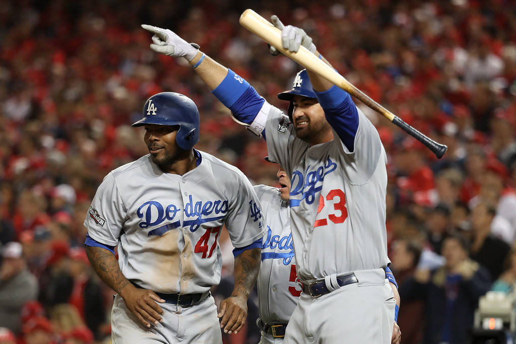 . WASHINGTON, DC - OCTOBER 13: Howie Kendrick #47 and Adrian Gonzalez #23 of the Los Angeles Dodgers celebrate after teammate Justin Turner #10 hit a two run RBI triple in the seventh inning against the Washington Nationals during game five of the National League Division Series at Nationals Park on October 13, 2016 in Washington, DC. (Photo by Rob Carr/Getty Images)