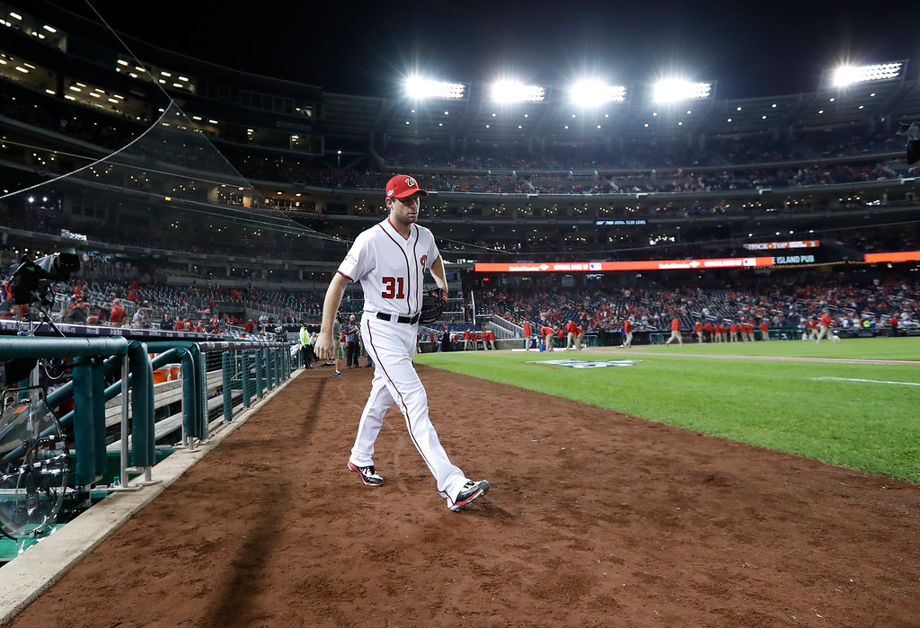 . Washington Nationals starting pitcher Max Scherzer walks onto the field for the start of Game 5 of baseball\'s National League Division Series, against the Los Angeles Dodgers at Nationals Park, Thursday, Oct. 13, 2016, in Washington. (AP Photo/Alex Brandon)