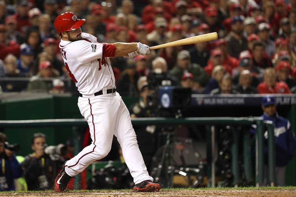 . WASHINGTON, DC - OCTOBER 13: Chris Heisey #14 of the Washington Nationals hits a two run home run in the seventh inning against the Los Angeles Dodgers during game five of the National League Division Series at Nationals Park on October 13, 2016 in Washington, DC. (Photo by Patrick Smith/Getty Images)