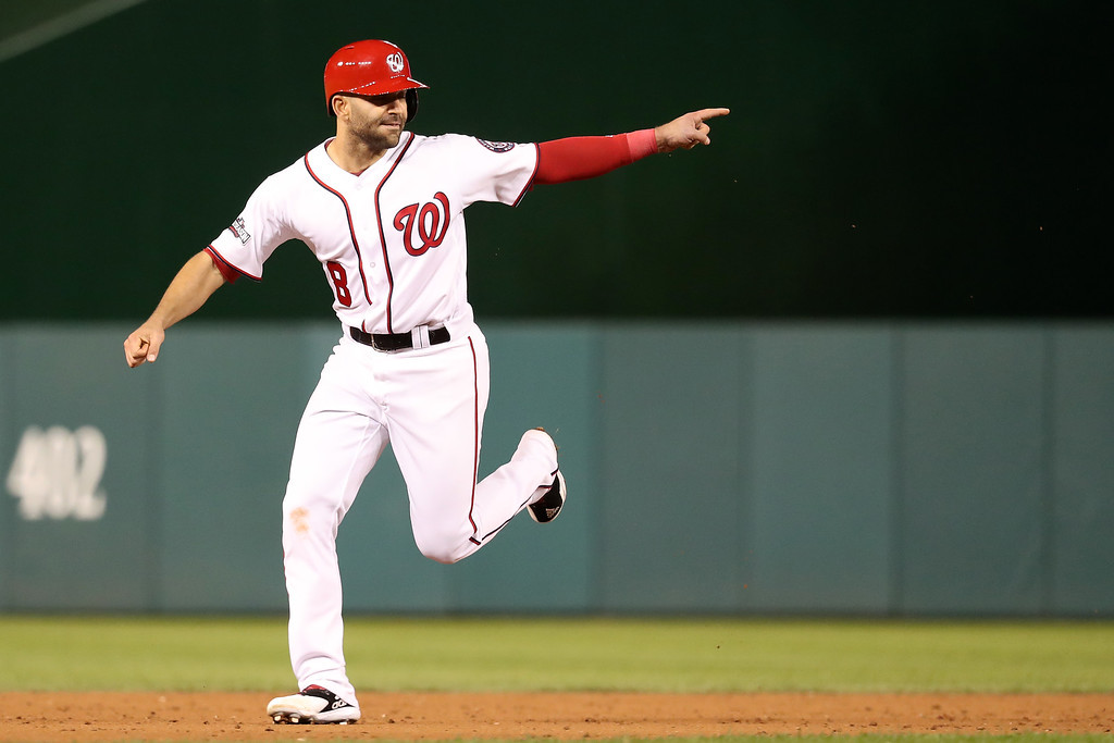 . WASHINGTON, DC - OCTOBER 13: Danny Espinosa #8 of the Washington Nationals celebrates after teammate Chris Heisey #14 (not pictured) hits a two run home run in the seventh inning against the Los Angeles Dodgers during game five of the National League Division Series at Nationals Park on October 13, 2016 in Washington, DC. (Photo by Rob Carr/Getty Images)