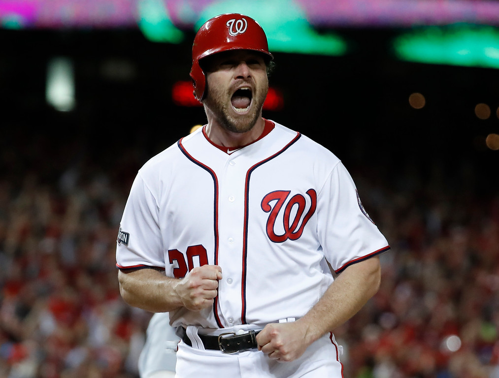 . Washington Nationals\' Daniel Murphy reacts after scoring during the second inning in Game 5 of baseball\'s National League Division Series against Los Angeles Dodgers, at Nationals Park, Thursday, Oct. 13, 2016, in Washington. (AP Photo/Alex Brandon)