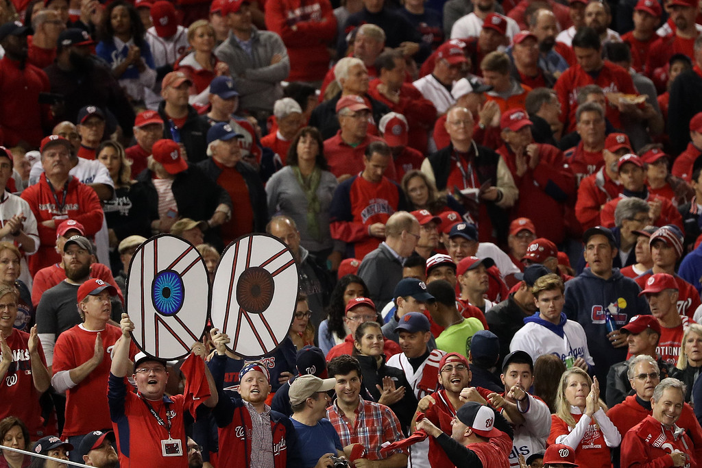 . WASHINGTON, DC - OCTOBER 13: Fans hold signs showing the eyes of Max Scherzer #31 of the Washington Nationals (not pictured) during game five of the National League Division Series between the Los Angeles Dodgers and the Washington Nationals at Nationals Park on October 13, 2016 in Washington, DC. (Photo by Patrick Smith/Getty Images)