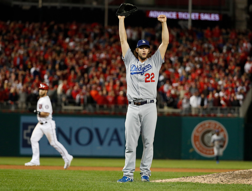 . Los Angeles Dodgers pitcher Clayton Kershaw (22) celebrates striking out Washington Nationals\' Wilmer Difo for the final out of Game 5 of a baseball National League Division Series, at Nationals Park early Friday, Oct. 14, 2016, in Washington. The Dodgers won 4-3. (AP Photo/Alex Brandon)