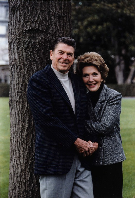 . President and First Lady Nancy Reagan pose on the White House South Lawn for a more casual official portrait, 11/22/1981.  Photo Credit: The Ronald Reagan Presidential Library and Museum