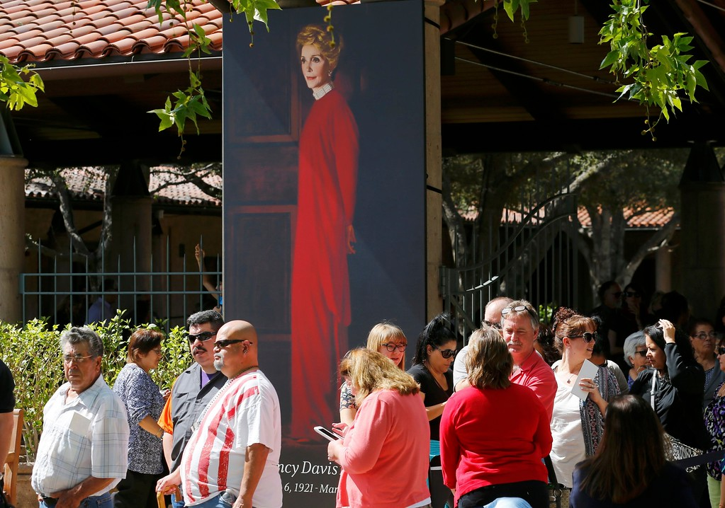 . SIMI VALLEY, CA - MARCH 10: A portrait of former first lady Nancy Reagan greets people as they arrive to pay their respects at the Ronald Reagan Presidential Library on March 10, 2016 in Simi Valley, California. Reagan died of heart failure at the age of 94. (Photo by Mike Blake-Pool/Getty Images)