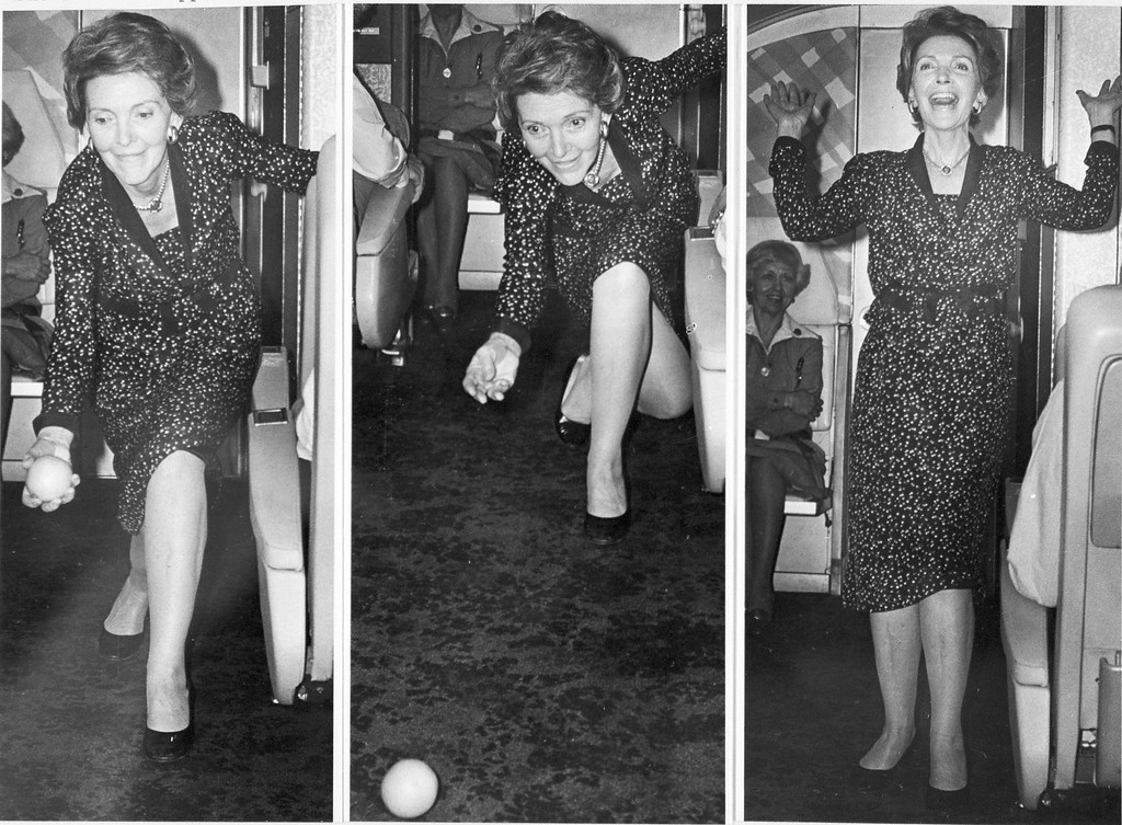 . Nancy Reagan, wife of presidential candidate Ronald Reagan, is shown in combo images as she rolls an orange down the aisle of a chartered plane, hoping it will return toward the tail section as the craft inclines upward on its take-off for Toledo, Ohio, in May 1980.  She received applause from travling reporters for her trick. As first lady, Nancy Reagan continued her habit of rolling an orange down the aisle of Air Force One for good luck.  (AP Photo)
