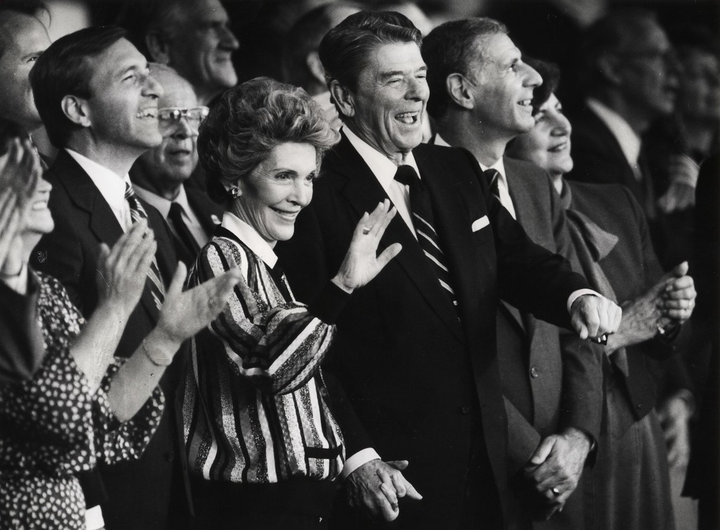 . 11/3/86 - File - At a campaign pep rally at Orange County Fairgrounds Amphitheater. Left to right- Senate candidate Ed Zschau with Nancy Reagan waving to fans- Pres. Ronald Reagan laughing and Gov. George Deukmejian. The groupwas having a good time watching the carnival of events at the close of the campaign rally. (Los Angeles Daily News file photo)