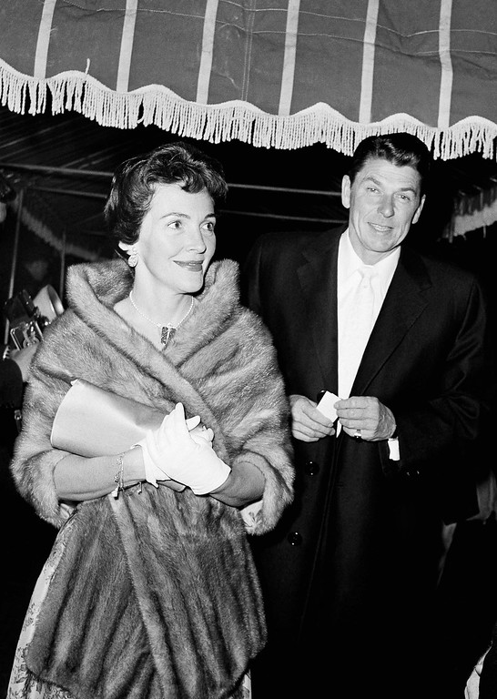 ". Actor Ronald Reagan and wife, Nancy, arrive for press premiere of ""Imitation of Life\"" in Hollywood, Calif. on Feb. 18, 1959. (AP Photo/Harold Matosian)"