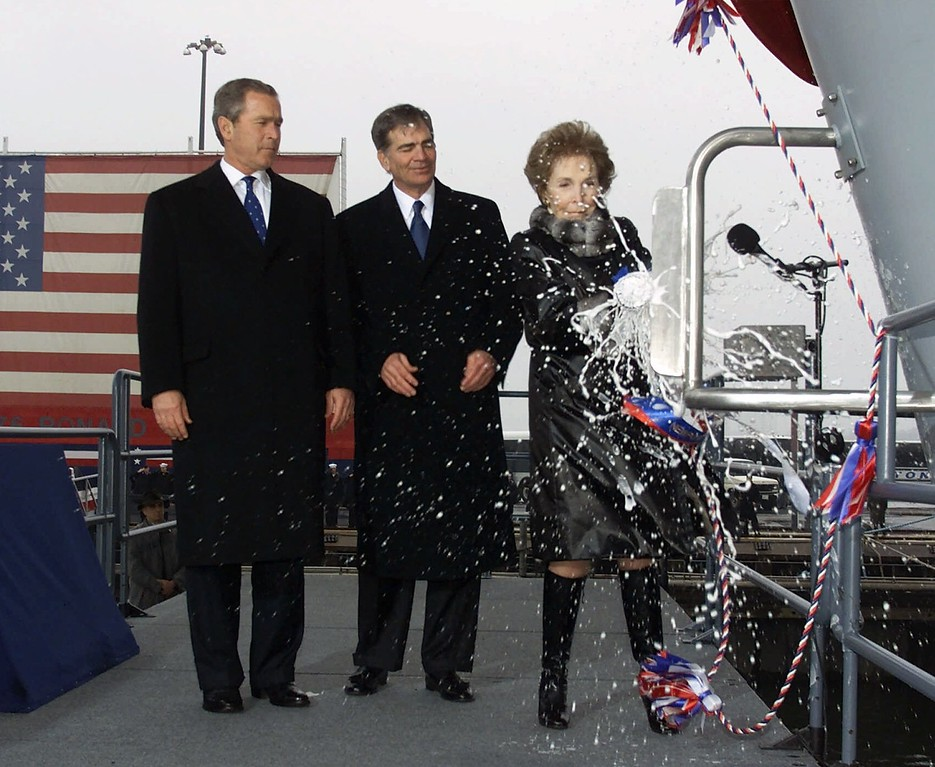 . Nancy Reagan reacts after christening the nuclear aircraft carrier Ronald Reagan, as President Bush, left, and Newport News Shipbuilding Chief Executive Officer William Fricks, center, look on  Sunday, March 4, 2001, in Newport News, Va. (AP Photo/Rick Bowmer)