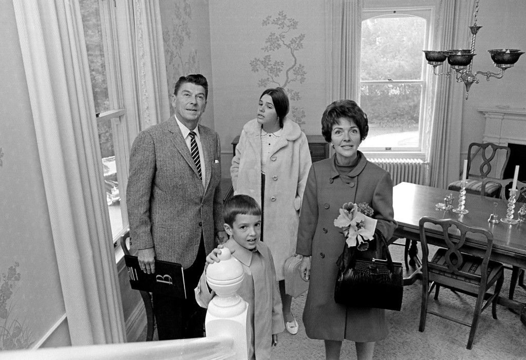 . California Gov.-elect Ronald Reagan and his wife, Nancy Reagan, and two children, Patricia, 13 and Ronald Jr., 8,  tour their new home, the Executive Mansion, after their arrival in Sacramento, Calif., in this Jan. 1, 1967 black-and-white file photo.  (AP Photo/Walt Zeboski, File)